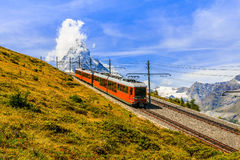 Zermatt,Switzerland. Famous electric red tourist train coming down from the Gornergrat station in Zermatt, Valais region, Switzerland, Europe stock photography