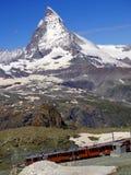 Zermatt Switzerland, green car-free city electric train Stock Photo