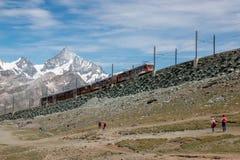 Gornergrat train with tourist is going to Matterhorn mountain royalty free stock photo