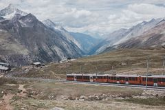 Gornergrat train with tourist is going to Matterhorn mountain. Zermatt, Switzerland - June 24, 2017: Gornergrat train with tourist is going to Matterhorn stock photo