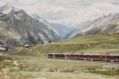 Gornergrat train with tourist is going to Matterhorn mountain. Zermatt, Switzerland - June 24, 2017: Gornergrat train with tourist is going to Matterhorn stock images