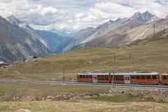 Gornergrat train with tourist is going to Matterhorn mountain stock photography