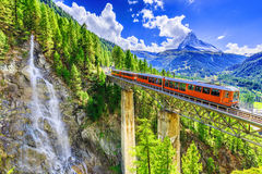 Zermatt, Switzerland. Gornergrat tourist train with waterfall, bridge and Matterhorn. Valais region royalty free stock images