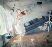 Zero gravity girl. Young beautiful lady fly in zero gravity room. creative concept stock photos