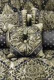 Zero Saturation. Group of pillows with an old fashioned pattern (effect achieved through greatly reducing saturation and slight hue manipulation Stock Image