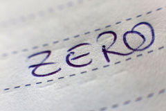 Zero spelled on lined paper Stock Photography