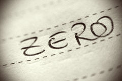 Zero spelled on lined paper Royalty Free Stock Images