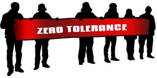 ZERO TOLERANCE on red banner held by people silhouettes at rally. Royalty Free Stock Photography