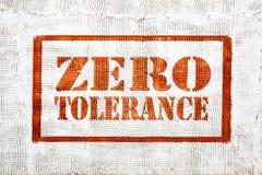 Zero tolerance graffiti on stucco wall. Zero tolerance - red graffiti sign on a white stucco wall Stock Images
