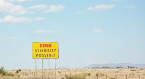 Zero visibility possible road sign new mexico desert Stock Photos