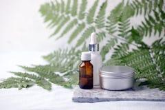 Zero waste bathroom accessories, natural sisal brush, aroma oil, metal jar, essential oil on marble plate, minimal eco-friendly. Background, minimal stylish set stock photo
