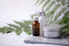 Zero waste bathroom accessories, natural sisal brush, aroma oil, metal jar, essential oil on marble plate, minimal eco-friendly. Background, minimal stylish set royalty free stock image