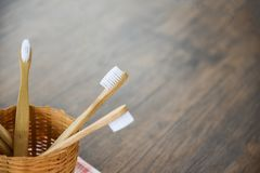 Zero waste bathroom use less plastic concept / bamboo toothbrush in basket stock photos