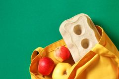 Zero waste concept. Bright yellow cotton product bag and tray with chicken eggs stock photography