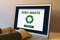 Zero waste concept on laptop computer screen on wooden table. Hands typing on a keyboard. All screen content is designed by me stock photo