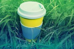 Zero waste concept. Stylish reusable eco coffee cup and green grass royalty free stock photos