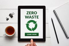 Zero waste concept on tablet screen with office objects. On white wooden table. All screen content is designed by me. Flat lay royalty free stock photos