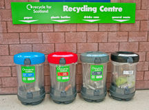 Zero waste in Scotland ?. Colorful recycling  bins with red, blue, gray and black lids for paper, plastic bottles, drinks cans and general waste aimed at Royalty Free Stock Photo