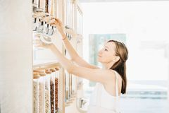 Free Zero Waste Shop. Girl Buying In Sustainable Plastic Free Grocery Store Stock Images - 161005964