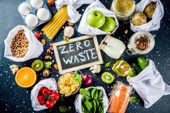 Zero waste shopping concept. Zero waste shopping and sustanable lifestyle concept, various farm organic vegetables, grains, pasta, eggs and fruits in reusable royalty free stock images