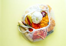 Zero waste shopping. Concept. Cotton bag full of vegatables on yellow background. bying product with out package stock images