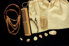 Zero waste women& x27;s accessories, natural brush, wooden hair comb and beads, straw hat, reusable cotton hand made bag royalty free stock images