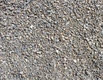 Zerquetschte Steinbeschaffenheit Kleiner Steinhintergrund steinschotter stockfoto