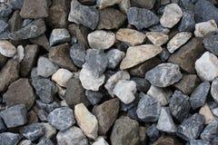 Zerquetschter Felsen Stockfoto