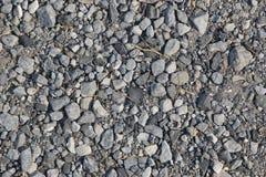 Zerquetschter Felsen Stockbild