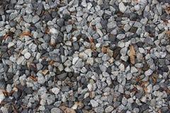 Zerquetschter Steinfelsenbeschaffenheitshintergrund Stockbild