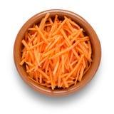 Zerriebene Karotte in der Schüssel Lizenzfreie Stockfotografie