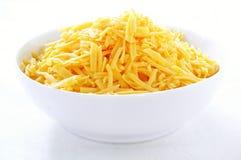 Zerriebener Cheddar-Käse Lizenzfreie Stockfotos