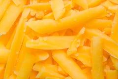 Zerriebener Cheddarkäsekäse Lizenzfreie Stockbilder