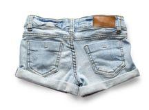 Zerrissene handgemachte kurze Jeanshose Stockbild