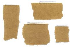 Zerrissene und auf Band aufgenommene Papierbeutel-Ansammlung Lizenzfreie Stockfotos