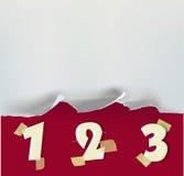 Zerrissener Papierhintergrund mit Zahlen Lizenzfreie Stockfotografie