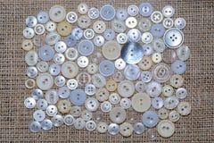 Zerstreut auf Textilknöpfe Lizenzfreies Stockfoto