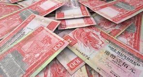 Zerstreuter Banknoten-Stapel Stockfoto