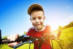 Zes éénjarigenjongen op een fiets Stock Afbeeldingen