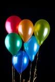Zes ballons op zwarte Royalty-vrije Stock Fotografie