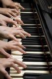Zes handen op piano Stock Afbeeldingen