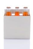 Zes Pak Oranje Flessen van de Soda Stock Afbeelding