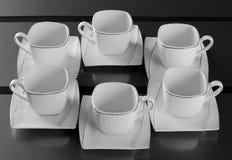 Zes porseleinkoppen van koffie royalty-vrije stock foto's