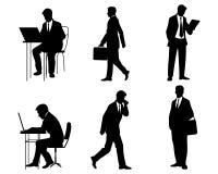 Zes zakenliedensilhouetten Stock Foto