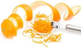 Zest and peel of orange. Peel and zest of an orange fruit on white background Royalty Free Stock Photos