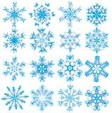 Zestien blauwe sneeuwvlokken Stock Afbeeldingen