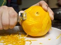 Zesting an Orange Royalty Free Stock Image