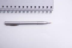 zeszyt aspiral długopis Fotografia Stock