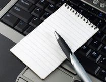 zeszyt komputerowy długopis Obraz Royalty Free