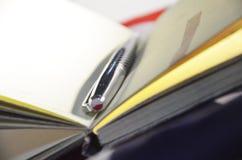 zeszyt otwarte długopis Zdjęcie Stock